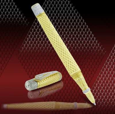 Golden pen 18 karat with diamond graving and diamonds