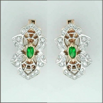 Earring with diamonds and emeralds