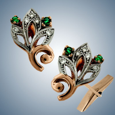 Cuff links with diamonds and emeralds